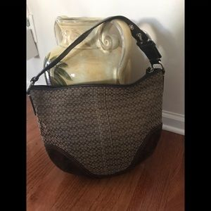 Large signature Coach bag with leather accent